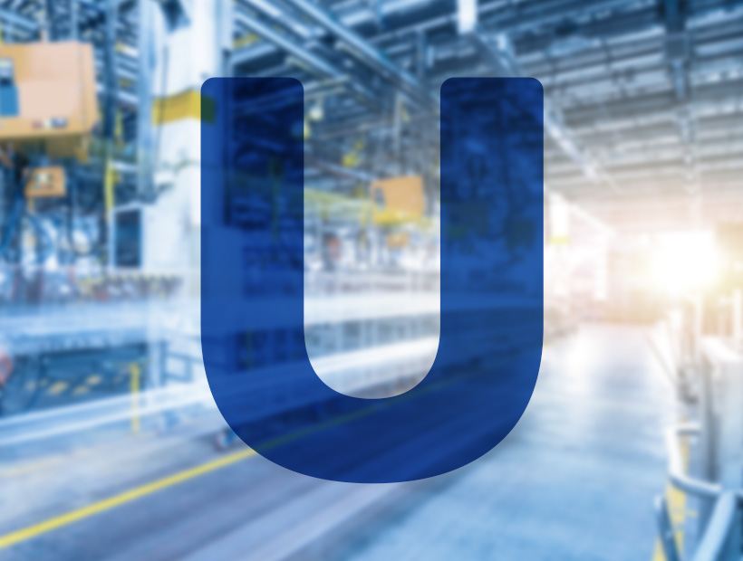 Factory background and letter u overlay
